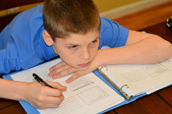Young boy drifts from his concentration while studying TFGP.